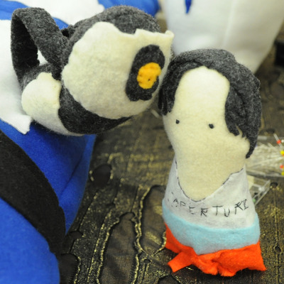 Hand sewn chell and glados from portal 2 felt plushies
