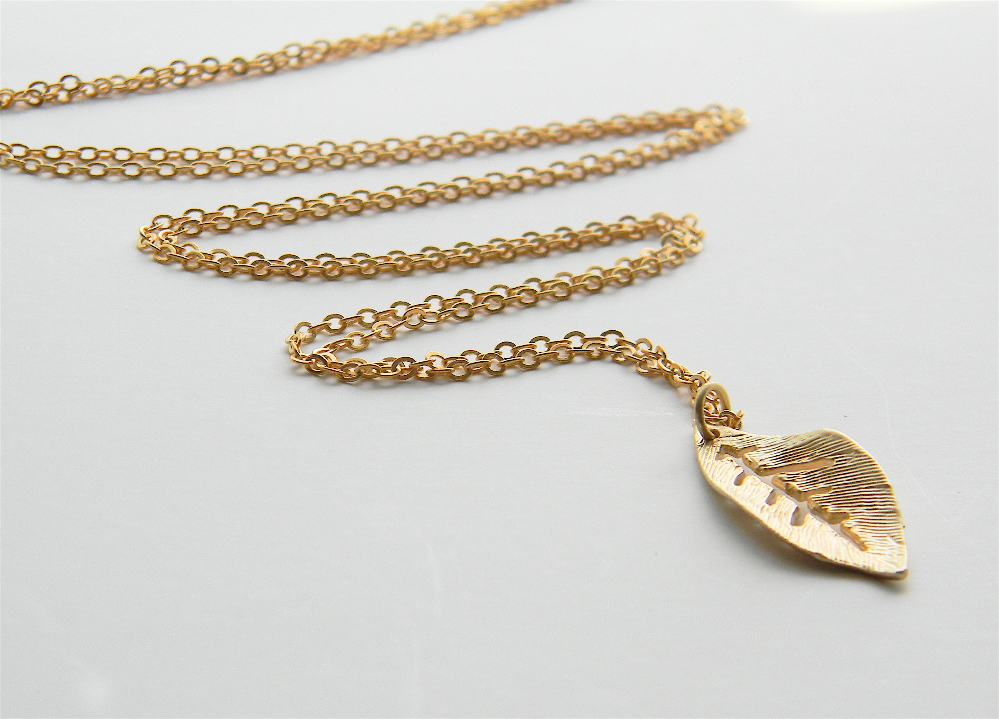 Bylolab gold plated leaf pendant on 24 matte gold chain online gold plated leaf pendant on 24 matte gold chain thumbnail aloadofball Choice Image