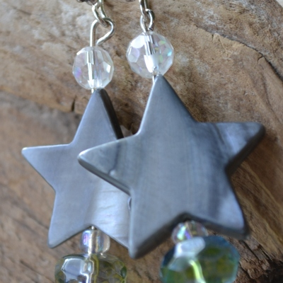 stella- mother of pearl star earrings with blue crystal accents and bali silver fish hooks