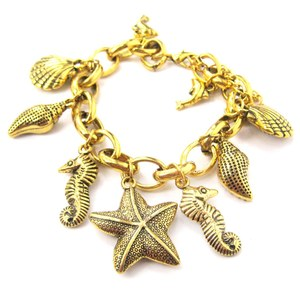 Starfish Seahorse Dolphin Sea Creatures Charm Bracelet in Gold