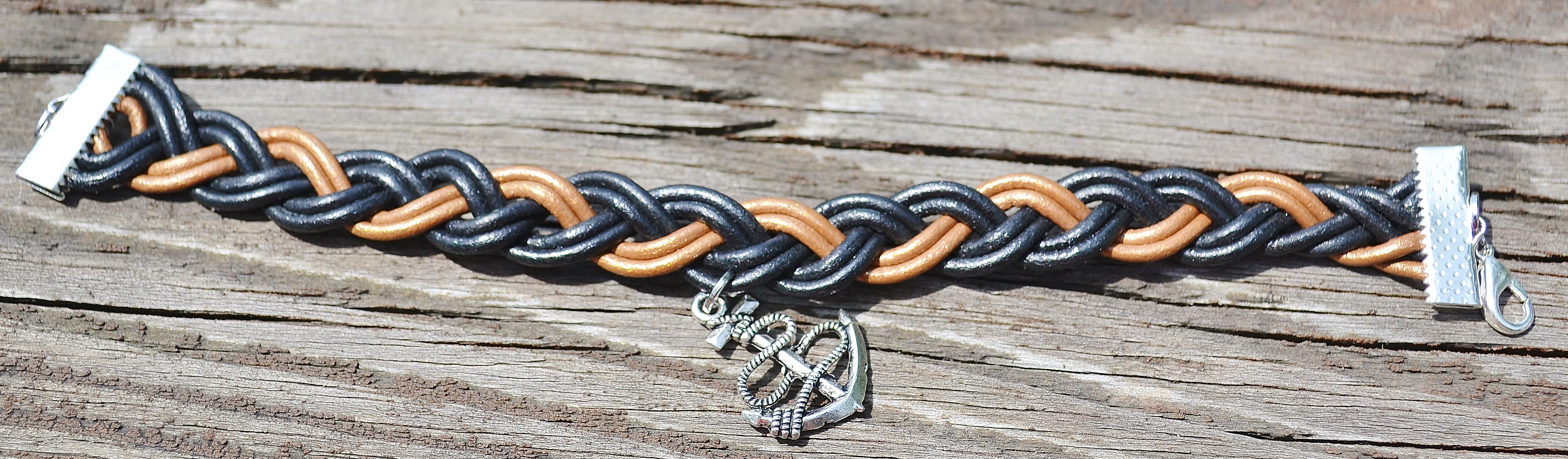 Bryn Braided leather anchor charm bracelet silvertone · Dena