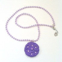purple floral rhinestone medallion with plastic pearl garland string