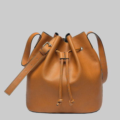 Easton drawstring bucket bag (tan) by melie bianco
