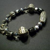 "6"" Black and silver beaded wire bracelet"