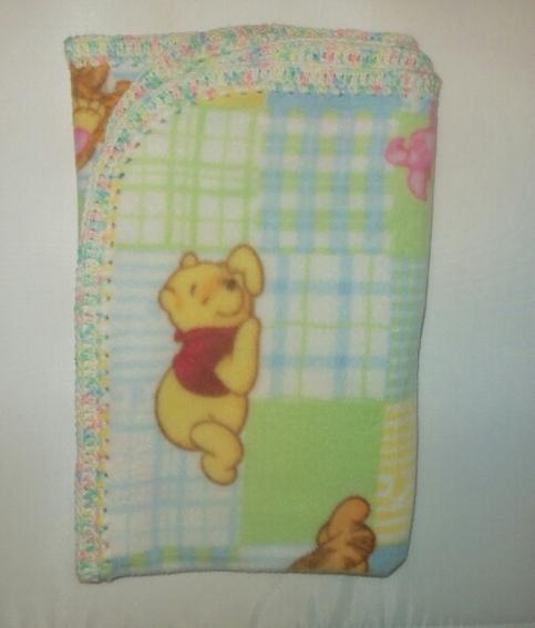 Multi Pastel Trim Winnie The Pooh Fleece Baby Blanket On