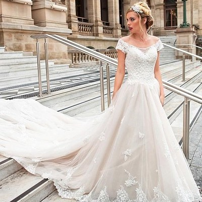 9bd8debd80d Off-the-shoulder cathedral train wedding gown with lace bodice
